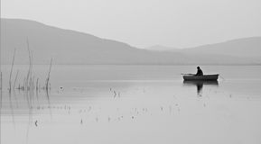 Boat fishing. A man is fishing in a boat at Lake Balaton stock image