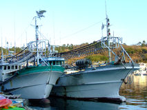 Boat. Fishing boats were in port,waiting for a new release in the sea Stock Image