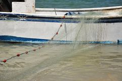 Boat and fishing net,in the sea stock photos