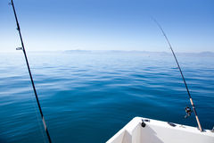 Boat fishing rod in mediterranean blue sea Royalty Free Stock Images