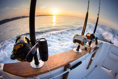 Boat fishing rods. Over a beautiful cloudy seascape royalty free stock photos