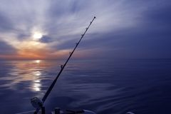 Boat fishing sunrise on mediterranean sea ocean Stock Images