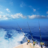Boat fishing trolling in deep blue ocean offshore. In Mediterranean sea royalty free stock images