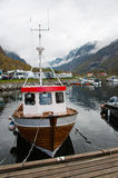 The boat in a fjords harbor. The picture of the boat at the small norwegian village harbor in fjords royalty free stock photography