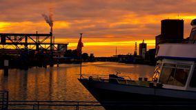 Boat with flag at sunset. Karlsruhe. Port. Boat with flag at sunset.  Karlsruhe. Port stock footage