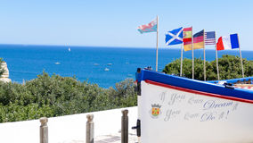 Boat with flags Portugal, Algarve Royalty Free Stock Photo