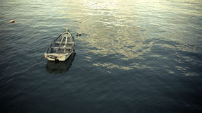 Boat on flat water Stock Images