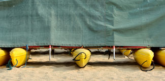 Boat floater covered. Boats floater arrange and covered on sand, shown as marine sport and symmetrical pattern Stock Photography