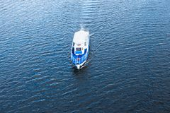 The boat floating in the blue Dnieper waters Stock Image