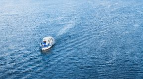 The boat floating in the blue Dnieper waters Stock Photography