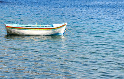 Boat floating on a calm sea Stock Photography