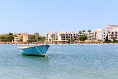 Boat floating in a calm water in spanish island of palma mallorca Stock Photo