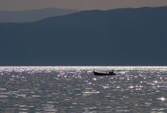 Boat floating in dusk Royalty Free Stock Image