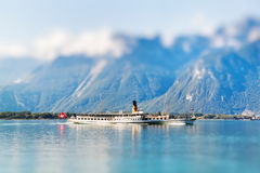 A boat floating in Geneva  lake in Switzerland. Miniature Royalty Free Stock Photos