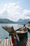 Boat floating on lake at Khao Sok National Park Stock Images
