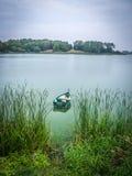Boat floating on Masurian lake Stock Photo