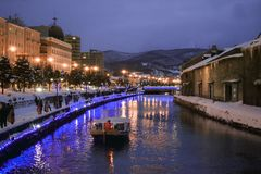 A boat is floating on Otaru Canal stock photography