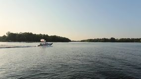 Boat floating on the river stock video footage