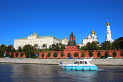 Boat floating on the river in the background of the Moscow Kremlin. Sunny day. Blue sky Stock Images