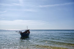 Boat Floating on the Sea. Seascape shot of a boat on the water looking out to Sea Stock Photo