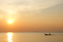 Boat floating in the sea at sunset Stock Photography