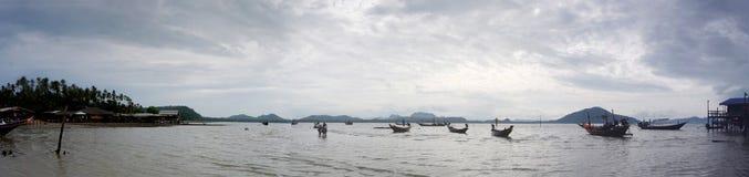 Boat floating while storm raining at Koh Phithak Island Stock Photo