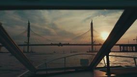 Boat floating to summer beautiful sunset. Bridge. Nature. Romantic evening. Landscape stock video footage