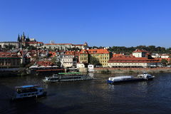 The boat floating on the Vltava River, historic buildings, Prague, Czech Republic Royalty Free Stock Photos
