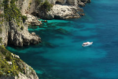 Boat floating on water, Capri. Sea view from hill in Capri. Boat floating next to cave Stock Photography