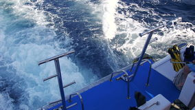 Boat is Floating on the Waves and Leaves a Trail in the Red Sea. View from stern of the ship. Yacht in the sea. Shot of a water wake of a tour boat leaving stock footage