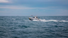 Boat floating on waves of the sea Stock Photos