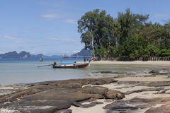 The boat floats on the background of the beautiful island.Traditional Thai Fishing boats with colorful ribbons and flags. Thailand Stock Photography