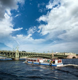 Boat floats on the background of the drawbridge Stock Photography