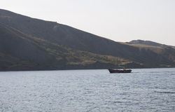 Boat floats on the Black Sea. Crimea Royalty Free Stock Images
