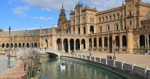 Boat floats on the canal on Plaza de Espana in Seville stock video