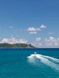 Boat floats on the island of Praslin Royalty Free Stock Photos