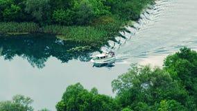 Boat floats Krka river Stock Photos