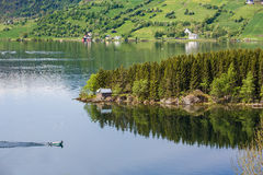 Boat floats on the mirrored surface of the lake Stock Photography