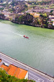 Boat floats on the river Douro,Porto, Portugal Stock Photo