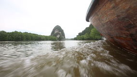 Boat floats on the river of mangroves. Thai boat floats on the muddy river of mangroves on a cloudy day stock video footage