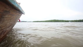 Boat floats on the river of mangroves stock video