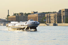 The boat floats on the river Neva stock images