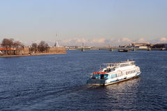 The boat floats on the river by the Peter and Paul. Fortress in St.-Petersburg Stock Photos