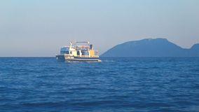 Boat Floats on sea in twilight, Mediterranean, Turkey, mountains in background. 4K stock footage