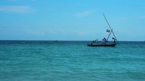 A boat floats in shallow water stock video footage