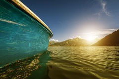 Boat floats on the water and the Sun Stock Image