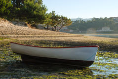 Boat. On the floor at low tide Royalty Free Stock Photo