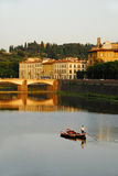 Boat in Florence. A boatman crossing the river Arno in Florence, Italy royalty free stock photos