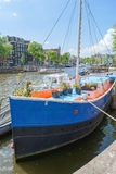 Boat with flowers in Amsterdam on a day Royalty Free Stock Photography