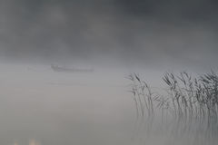 Boat in the fog. On the lake Royalty Free Stock Photography